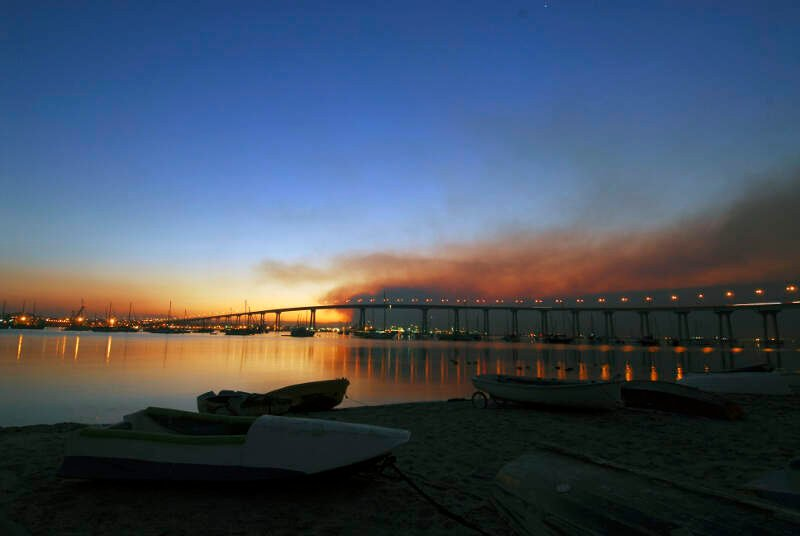 Us Navy  N S  The Sun Rises Over The Coronado Bay Bridge With Smoke From The Harris Fire Looming Overhead