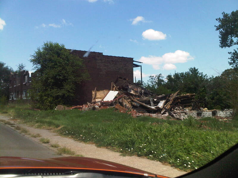 Severely Damaged Apartment Building And Debris