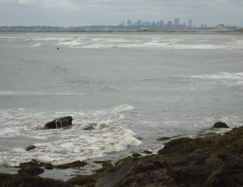 Lynn Massachusetts Surfers Riding Waves With Boston In Background