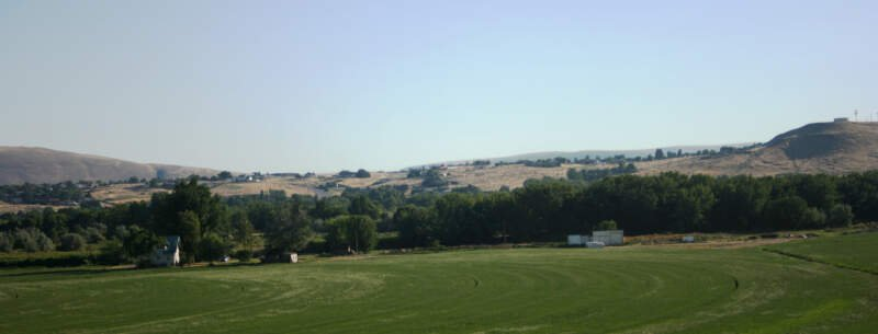 West Richland   As Seen Across Yakima River   Flat Top Hill To Right   Houses In Highlands Behind   July